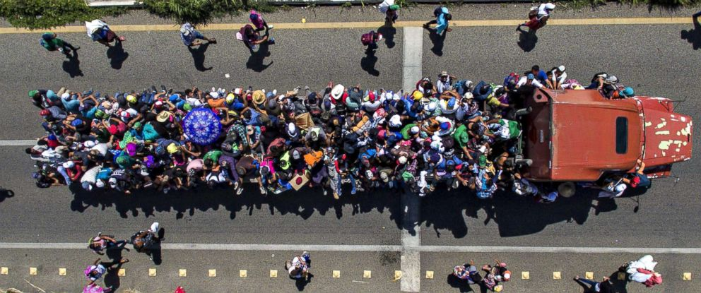 PHOTO: Aerial view of Honduran migrants on board a truck as they take part in a caravan heading to the U.S., in the outskirts of Tapachula, on their way to Huixtla, Chiapas state, Mexico, on Oct. 22, 2018.