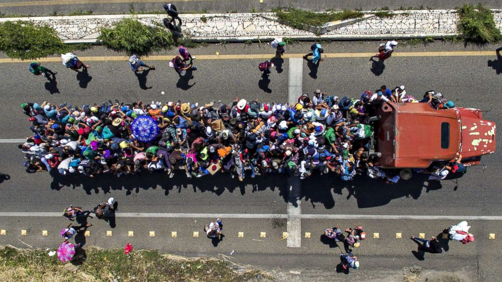 Aerial view of Honduran migrants on board a truck as they take part in a caravan heading to the US, in the outskirts of Tapachula, on their way to Huixtla, Chiapas state, Mexico, on Oct. 22, 2018.