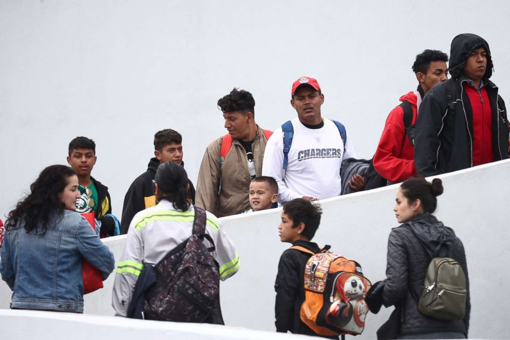 PHOTO: Members of a caravan of migrants from Central America enter the United States border and customs facility near Tijuana, Mexico, where they are expected to apply for asylum, May 2, 2018.