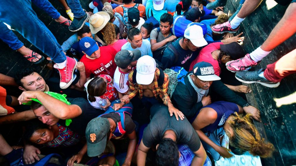 Honduran migrants taking part in a caravan heading to the US, aboard a truck in Metapa on their way to Tapachula, Chiapas state, Mexico on Oct. 22, 2018.