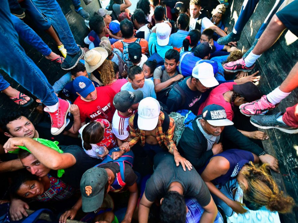 PHOTO: Honduran migrants taking part in a caravan heading to the US, aboard a truck in Metapa on their way to Tapachula, Chiapas state, Mexico on Oct. 22, 2018.