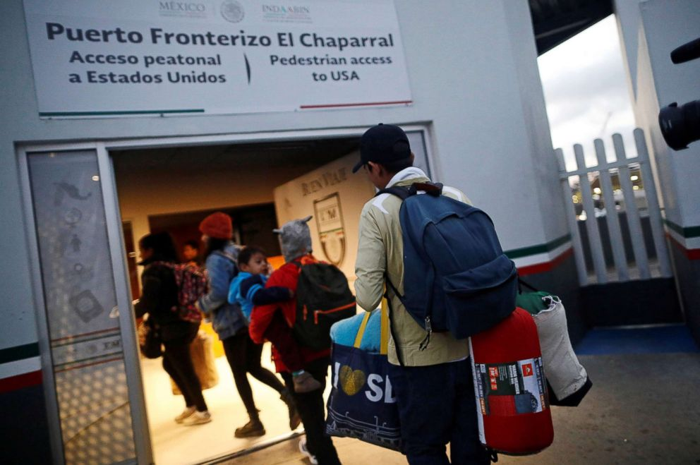 PHOTO: Members of a caravan of migrants from Central America enter the United States border and customs facility, where they are expected to apply for asylum, in Tijuana, Mexico, May 2, 2018.