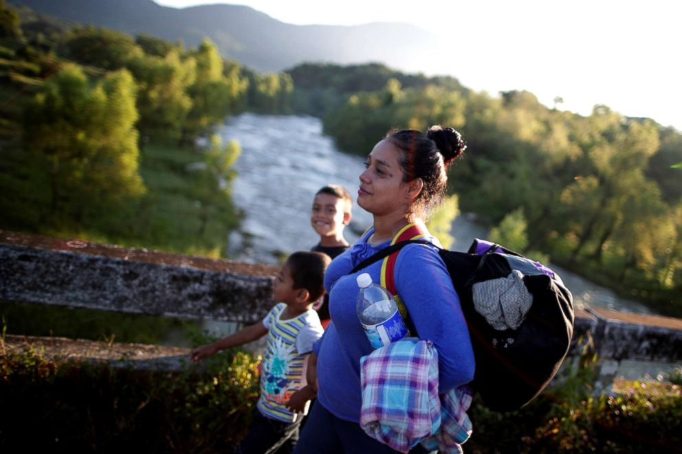 PHOTO: Glenda Escobar, 33, a migrant from Honduras, part of a caravan of thousands from Central America en route to the United States, walks with her children Denzel and Adonai, on their way to Pijijiapan from Mapastepec, Mexico, Oct. 25, 2018.