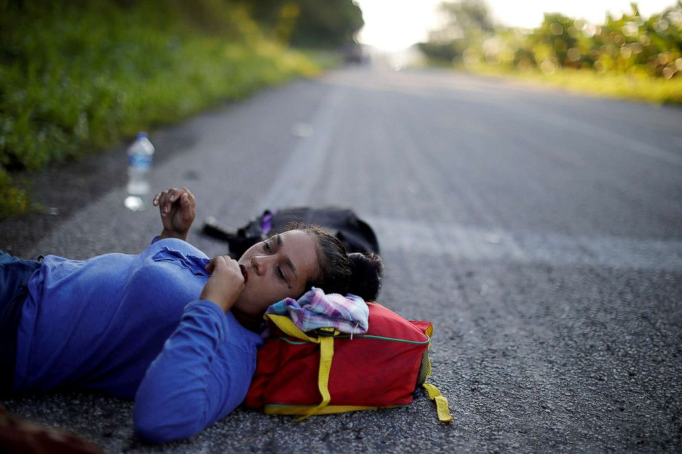 PHOTO: Glenda Escobar, 33, a migrant from Honduras, part of a caravan of thousands from Central America en route to the United States, rests on the road, on her way to Pijijiapan from Mapastepec, Mexico, Oct. 25, 2018.