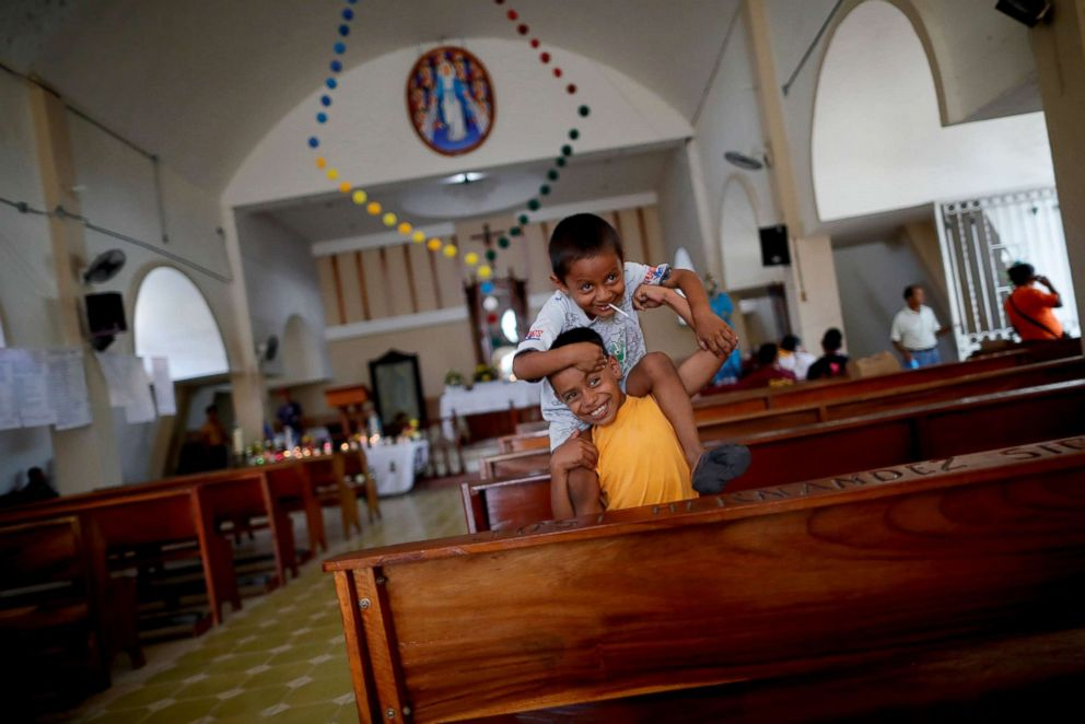PHOTO: Denzel, 8, and his brother Adonai, 5, migrants from Honduras, part of a caravan of thousands from Central America en route to the United States, play inside a church as they rest in San Pedro Tapanatepec, Mexico, Oct. 28, 2018.