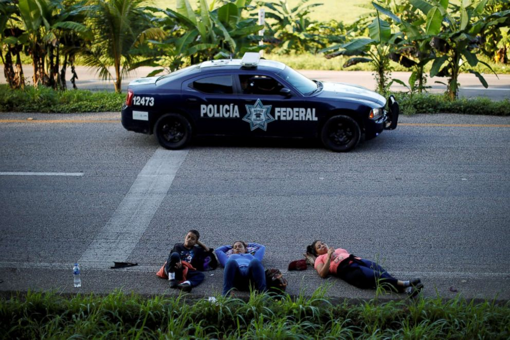 PHOTO: Glenda Escobar, 33, a migrant from Honduras, part of a caravan of thousands from Central America en route to the United State, rests on a road with her son Denzel, on their way to Pijijiapan from Mapastepec, Mexico, Oct. 25, 2018.