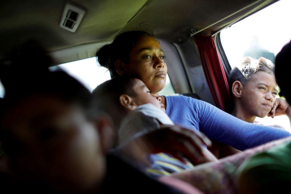 PHOTO: Glenda Escobar, 33, a migrant from Honduras, part of a caravan of thousands from Central America en route to the United States, takes a ride in a vintage car with her children as they walk to Pijijiapan from Mapastepec, Mexico, Oct. 25, 2018.