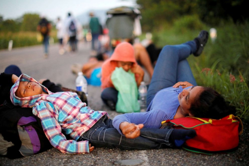 PHOTO: Glenda Escobar, 33, a migrant from Honduras, part of a caravan of thousands from Central America en route to the United States, takes a rest on the road with her children on their way to Pijijiapan from Mapastepec, Mexico, Oct. 25, 2018.
