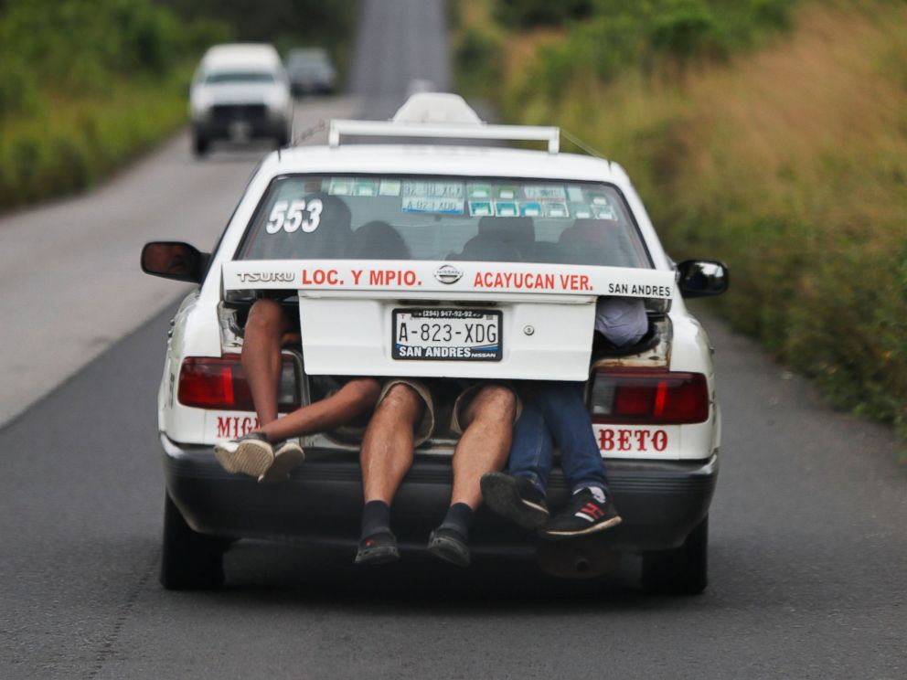 PHOTO: Central American migrants, part of the caravan hoping to reach the U.S. border, a ride on in the trunk of a taxi, in Acayucan, Veracruz state, Mexico, Saturday, Nov. 3, 2018.