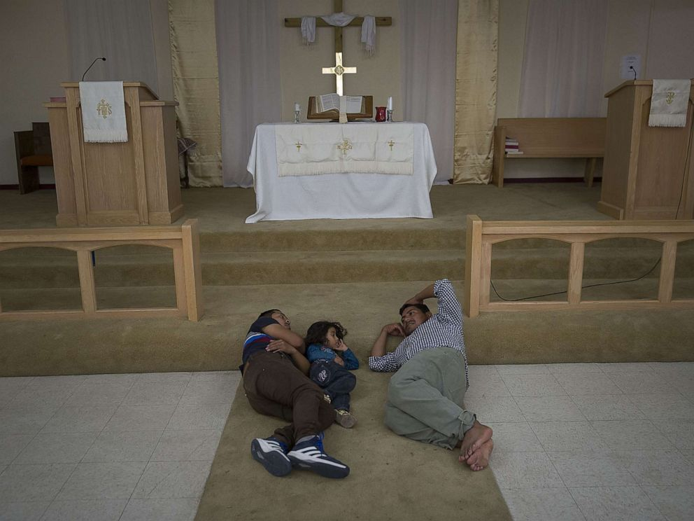 PHOTO: Migrants from Guatemala rest near the altar at the El Calvario Methodist Church which is housing migrants who are seeking asylum after being released by the U.S. Immigration and Customs Enforcement, June 3, 2019, in Las Cruces, New Mexico.