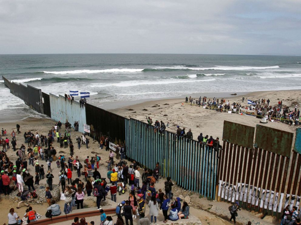 PHOTO: Members of a caravan of migrants from Central America and supporters gather on both sides of the border fence between Mexico and the U.S. as part of a demonstration, prior to preparations for an asylum request in the U.S., in Tijuana, Mexico.