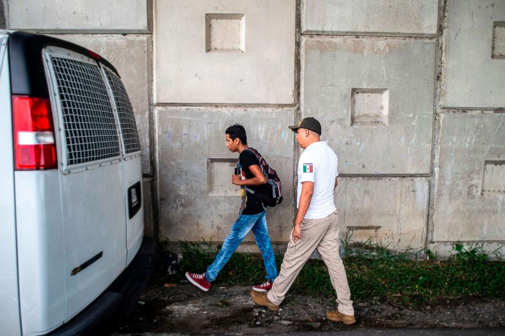 PHOTO: A Guatemalan migrant who traveled through the public transportation system without documents is detained by Mexican immigration agents in the outskirts of Ciudad Hidalgo, Chiapas state, Mexico, Aug. 10, 2018.