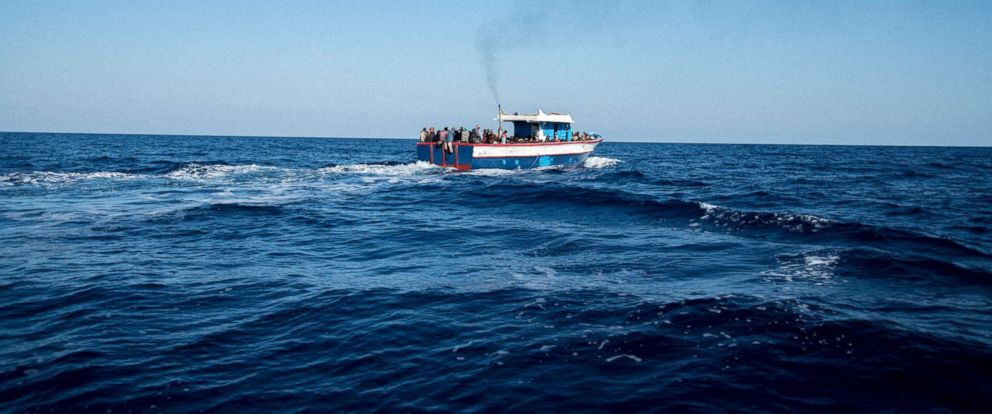 PHOTO: This Nov. 3, 2017 file photo shows migrants in a boat off the coast of Libya.