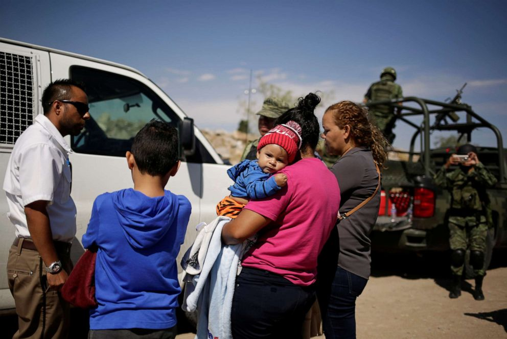 PHOTO: Honduran migrants are stopped by members of the Mexican National Guard in Anapra, on the outskirts of Ciudad Juarez, Mexico, June 28, 2019.