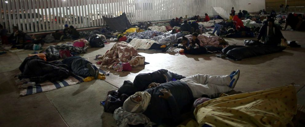 Members of a caravan of migrants from Central America sleep near the San Ysidro checkpoint after a small group of fellow migrants entered the U.S. border and customs facility, where they are expected to apply for asylum in Tijuana, Mexico, April 29, 2018.