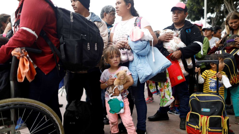 Members of a caravan of migrants from Central America wait to enter the United States border and customs facility, where they are expected to apply for asylum, in Tijuana, Mexico April 29, 2018.