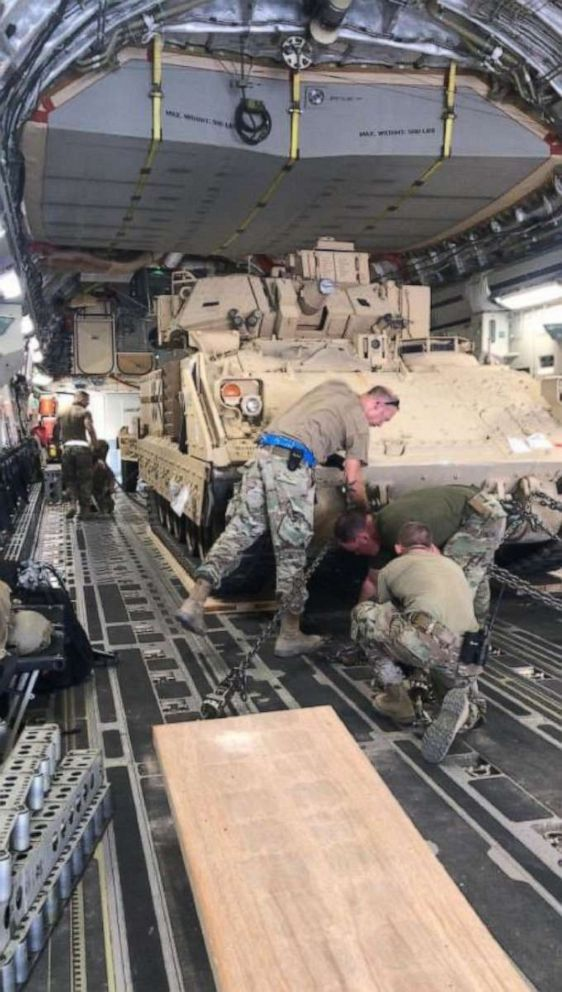 PHOTO: U.S. soldiers load M2A2 Bradley Fighting Vehicles headed to Deir ez Zor, Syria as part of a new U.S. troop deployment to defend the oil fields in that region.