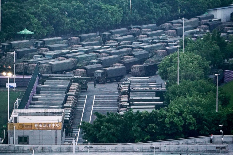 PHOTO: Chinese paramilitary vehicles are parked at the Shenzhen Bay Sports Center in Shenzhen, China, near the border with Hong Kong.