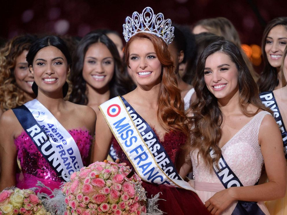 PHOTO: Miss Nord-Pas-de-Calais Maeva Coucke, center, poses with other contestants after winning the Miss France 2018 pageant in Chateauroux, central France, Dec. 16, 2017.