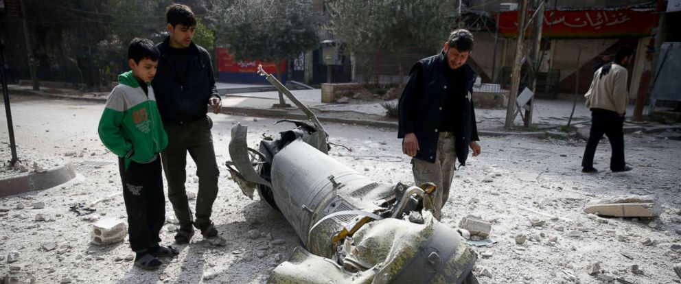 PHOTO: People inspect missile remains in the besieged town of Douma, in eastern Ghouta, Syria, Feb. 23, 2018.