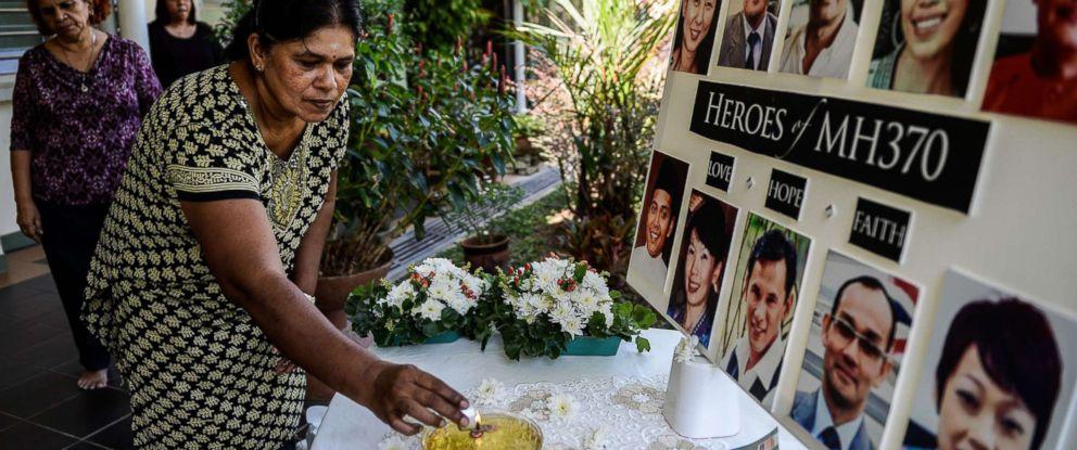 PHOTO: A school teacher lights a candle as she prays for passengers of missing Malaysia Airlines flight MH370 in Petaling Jaya on March 8, 2016.