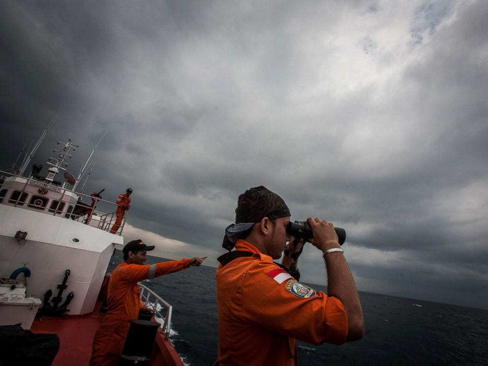 PHOTO: Indonesian national search and rescue agency personel watch over high seas during a search operation for missing Malaysia Airlines flight MH370 in the Andaman Sea on March 15, 2014.