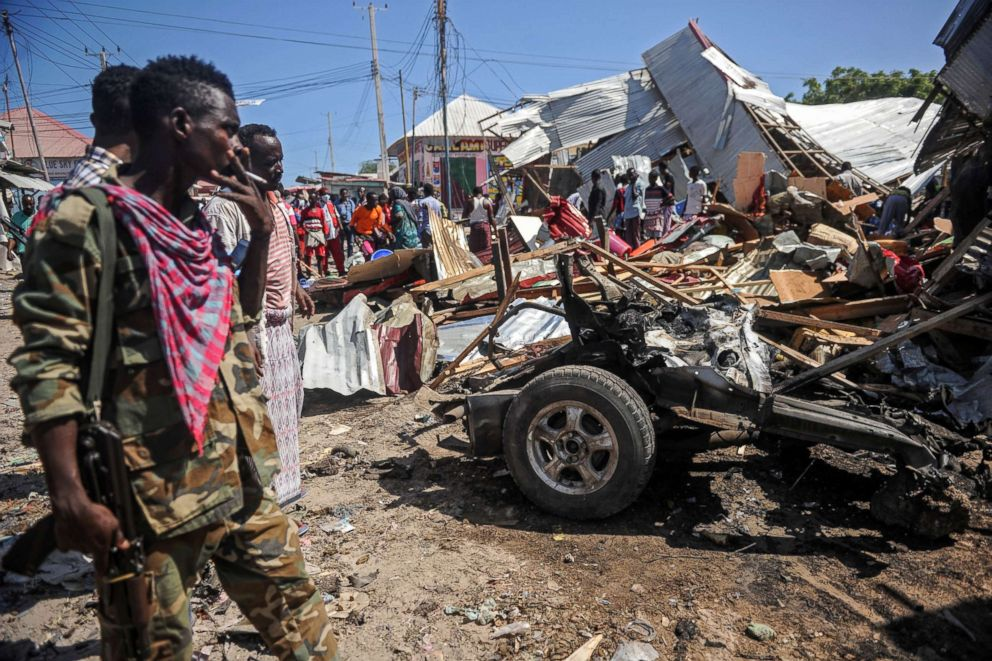 PHOTO: People gather by the site of a blast after a car bomb detonated at a busy market in the capital Mogadishu, Somalia, Nov. 26, 2018.