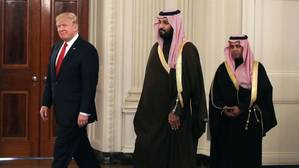 President Donald Trump walks into the State Dining Room to have lunch with Mohammed bin Salman, center, Deputy Crown Prince and Minister of Defense of the Kingdom of Saudi Arabia, at the White House, March 14, 2017 in Washington.