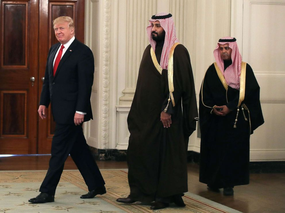 'PHOTO: President Donald Trump walks into the State Dining Room to have lunch with Mohammed bin Salman, center, Deputy Crown Prince and Minister of Defense of the Kingdom of Saudi Arabia,1_b@b_1the White House, March 14, 2017 in Washington.' from the web at 'https://s.abcnews.com/images/International/mohammed-bin-salman-05-gty-jc-171120_4x3_992.jpg'
