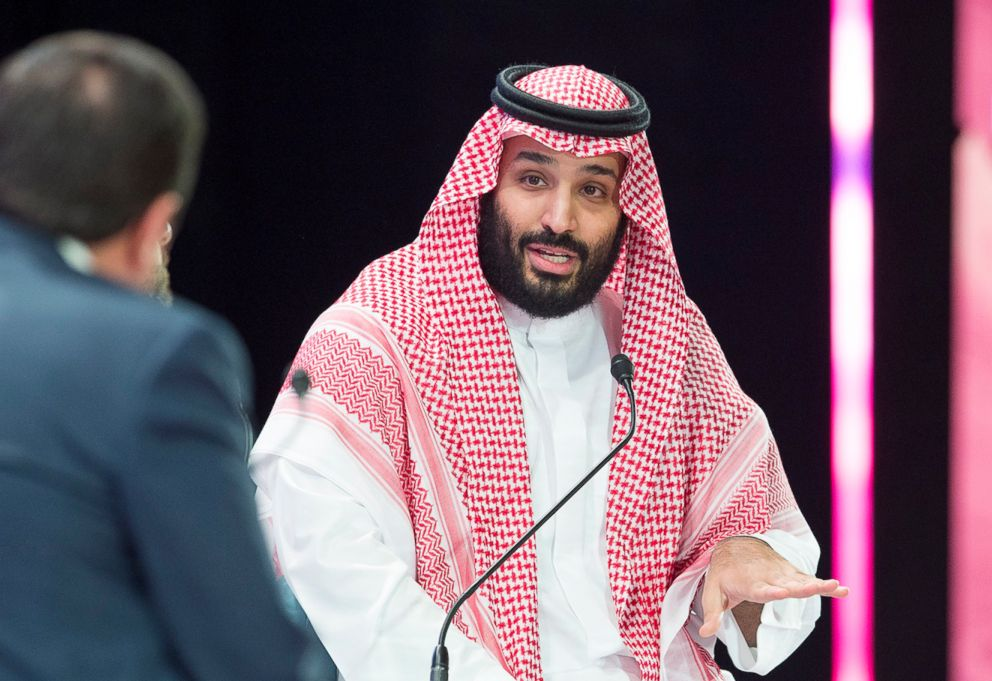 Khashoggi's son shakes hands with Saudi royal blamed for father's death