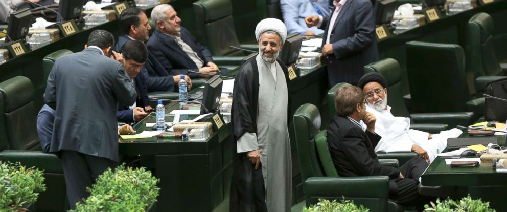 PHOTO: In this file photo, newly elected cleric Iranian lawmaker Mojtaba Zonnour, center, smiles while walking through parliament in an open session to choose the interim presiding board in Tehran, Iran, May 29, 2016.
