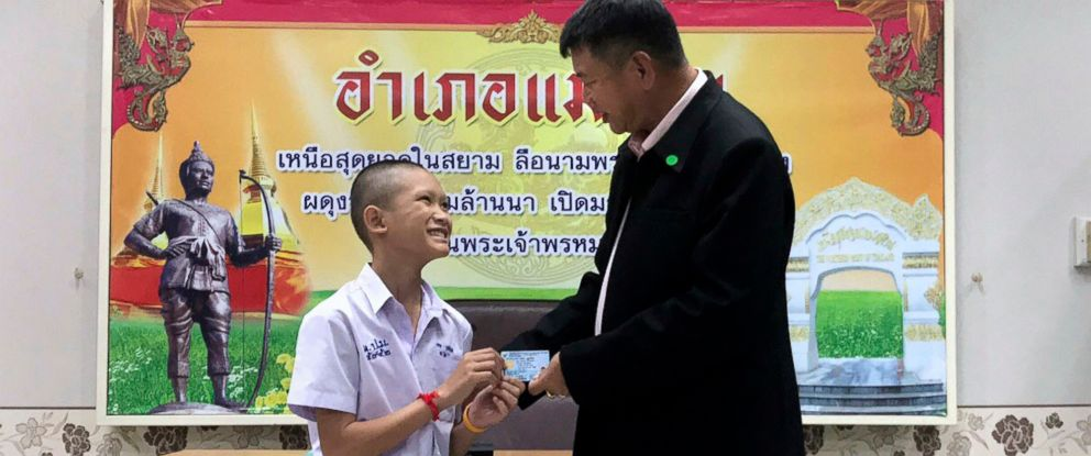 PHOTO: Mongkol Boonpiam, left, receives an identity card denoting Thai citizenship from Somsak Kunkam, Sheriff of Mae Sai during a ceremony in Chiang Rai province, Thailand, Aug. 8, 2018.