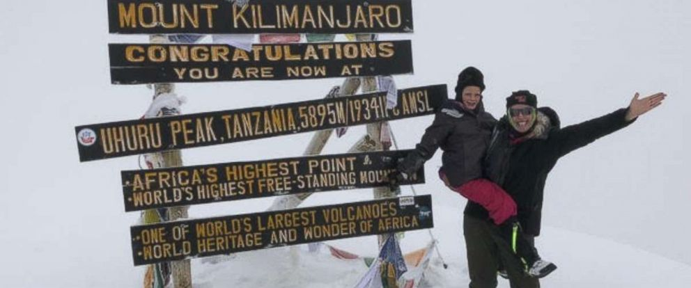 PHOTO: Hollie Kenney and her 7-year-old daughter, Montannah, pose at the summit of Mount Kilimanjaro.