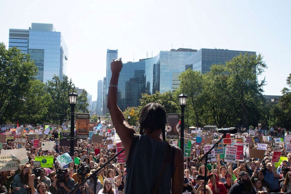 PHOTO: First Nations activist Caroline Crawley addresses the crowd as protesters gather outside the Ontario Legislature for the Climate Strike, in Toronto on Friday, Sept. 27, 2019.
