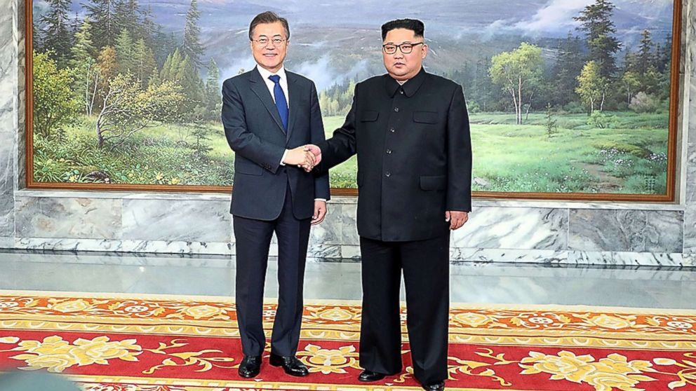 South Korean President Moon Jae-in (L) shakes hands with North Korean leader Kim Jong Un (R) before their meeting on May 26, 2018 in Panmunjom, North Korea, May 26, 2018.