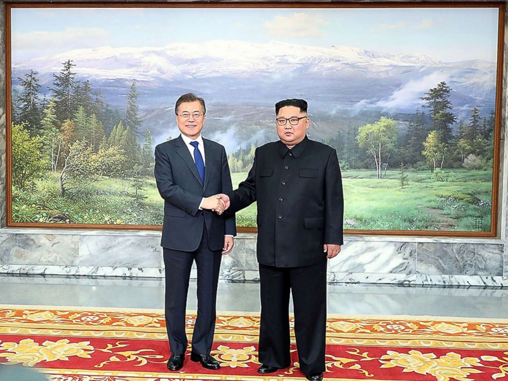 PHOTO: South Korean President Moon Jae-in (L) shakes hands with North Korean leader Kim Jong Un (R) before their meeting on May 26, 2018 in Panmunjom, North Korea, May 26, 2018.