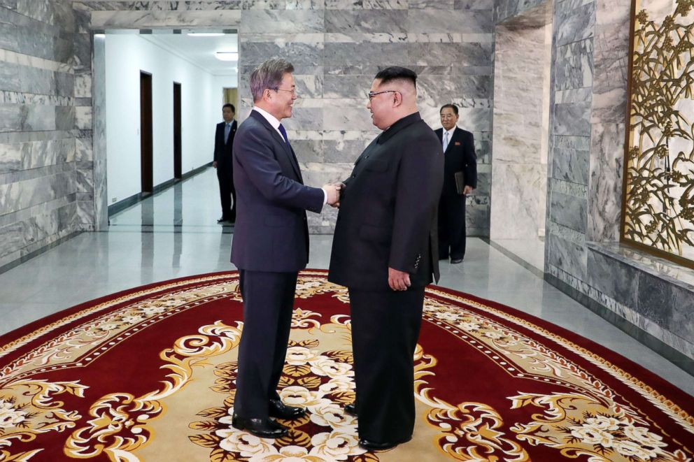 South Korea's President Moon Jae-in (L) shakes hands with North Korea's leader Kim Jong Un before their second summit at the north side of the truce village of Panmunjom in the Demilitarized Zone (DMZ) on May 26, 2018.