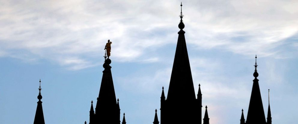 PHOTO: The angel Moroni statue, silhouetted against the sky, sits atop the Salt Lake Temple of The Church of Jesus Christ of Latter-day Saints in Salt Lake City, Utah, Jan. 3, 2018.