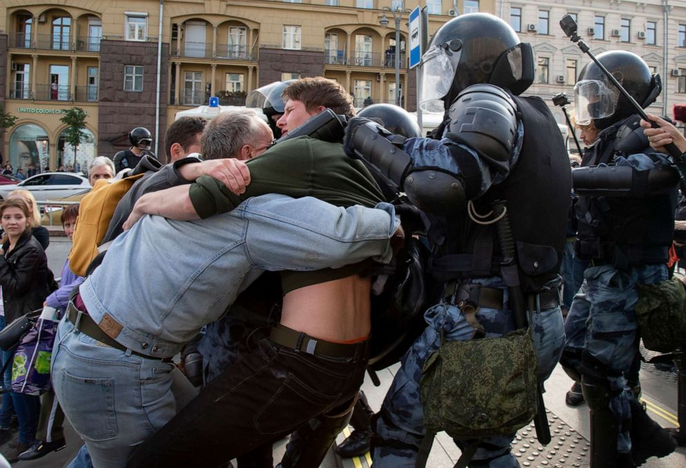 PHOTO: Police officers try to detain protestors during an unsanctioned rally in the center of Moscow, Russia, Aug. 3, 2019.