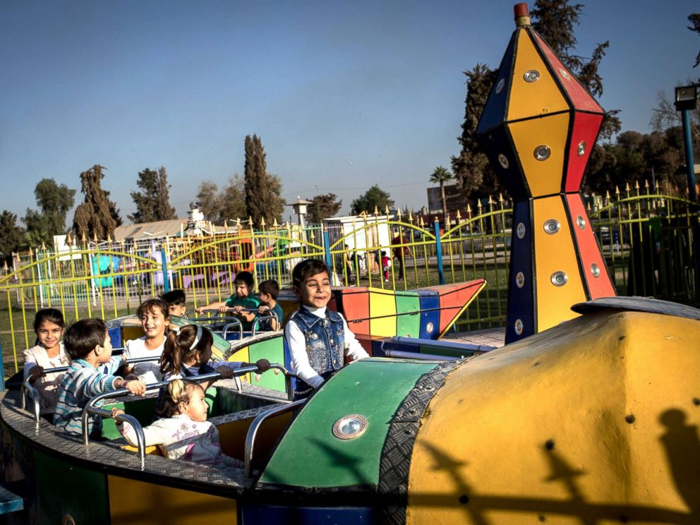 PHOTO: Children enjoy a train ride at the Mosul Amusement Park on Nov. 4, 2017.