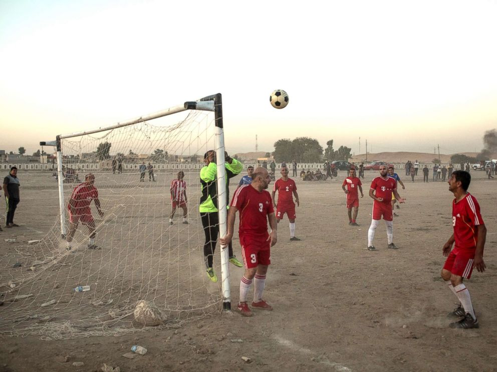PHOTO: People play football in East Mosul on Nov. 5, 2017.