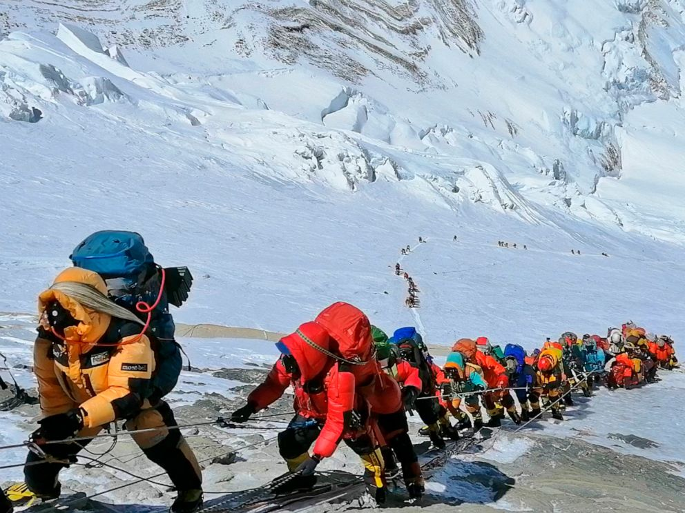 PHOTO: A long queue of mountain climbers line a path on Mount Everest just below camp four, in Nepal, May 22, 2019.