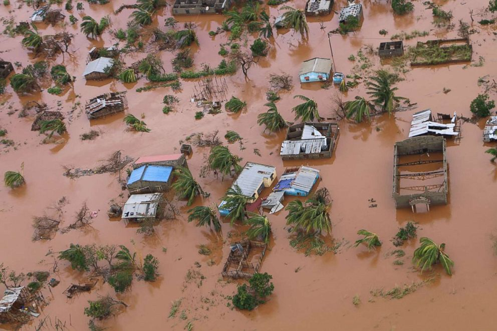 A picture shows houses in a flooded area of Buzi, central Mozambique, March 20, 2019, after the passage of cyclone Idai. International aid agencies raced to rescue survivors and meet humanitarian needs in three impoverished countries battered by one of the worst storms to hit southern Africa in decades.