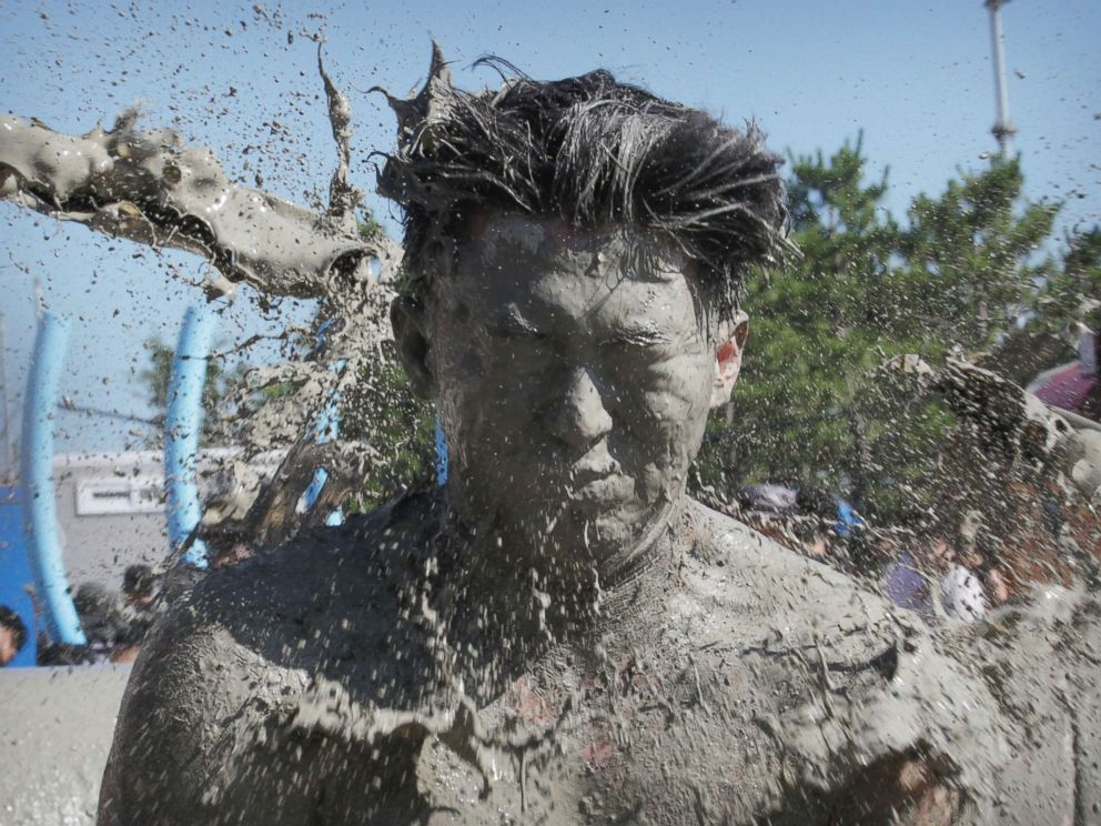 PHOTO: A mans face is hit by mud water during the Boryeong Mud Festival at Daecheon Beach in Boryeong, South Korea, July 14, 2018.