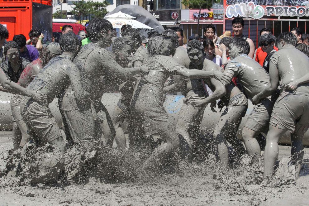PHOTO: People play in a mud pool during the Boryeong Mud Festival at Daecheon Beach in Boryeong, South Korea, July 14, 2018.