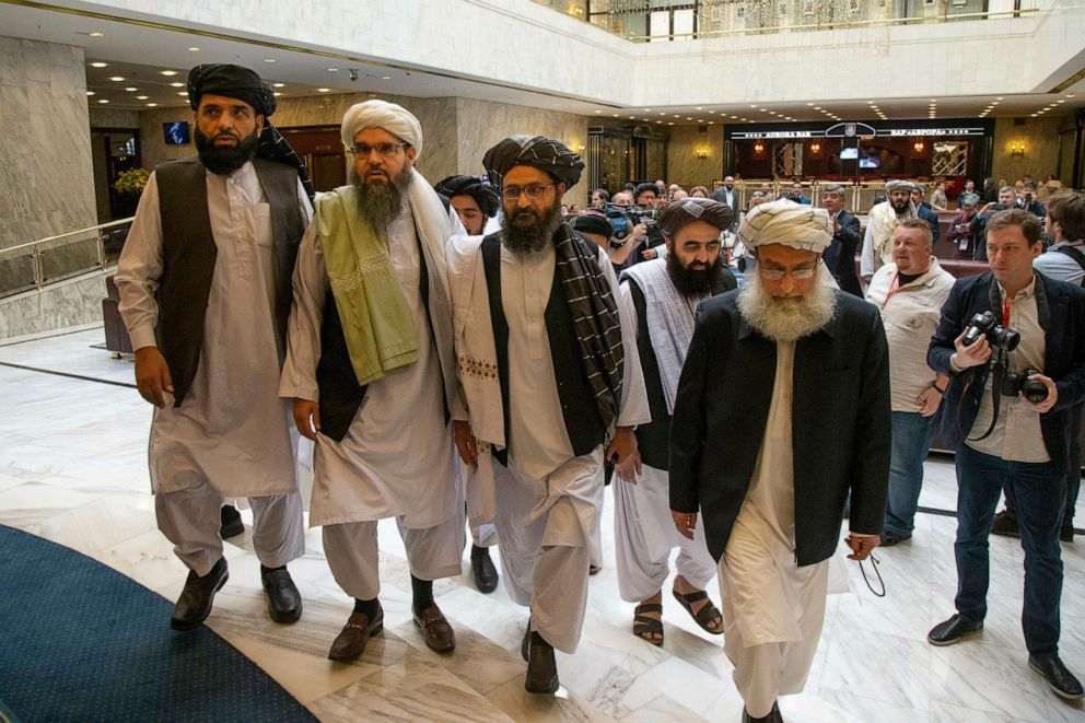 PHOTO: Mullah Abdul Ghani Baradar, the Taliban groups top political leader, third from left, arrives with other members of the Taliban delegation for talks in Moscow, Russia, May 28, 2019.