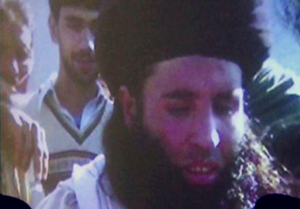 In this file image made from video broadcast on Thursday Nov. 7 2013 undated footage of Mullah Fazlullah is shown on a projector in Pakistan
