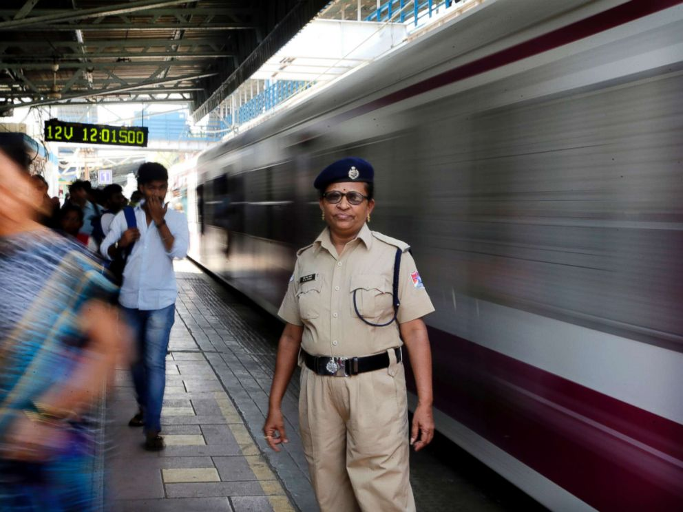PHOTO: A railway police officer stands at Matunga Road train station on Western Railway line in Mumbai, India, Thursday, March. 8, 2018.