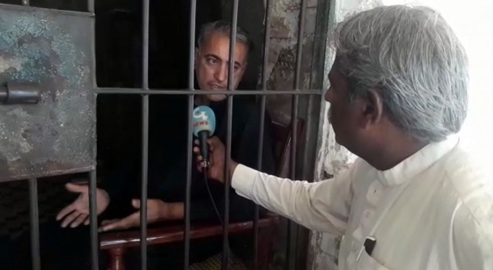 PHOTO: Muzaffar Ghanghro, a physician accused of allegedly knowingly spreading HIV, speaks to journalist Muhammad Yousaf Shaikh, in Larkana, Pakistan, in May 2019.