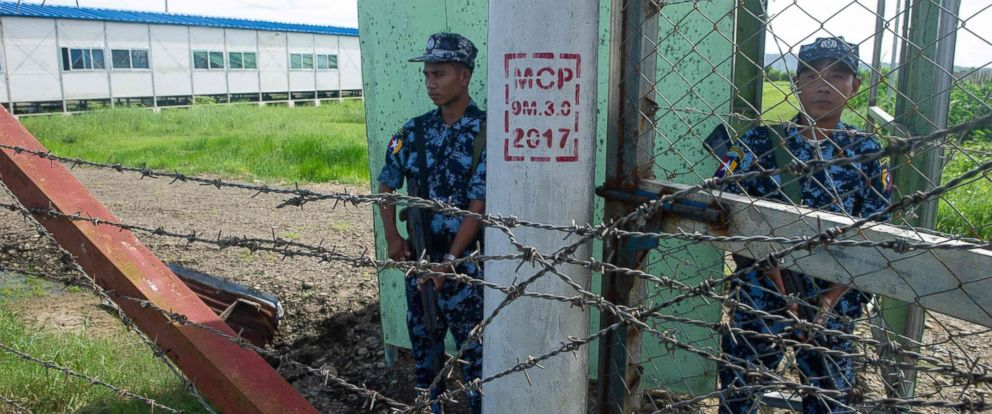 PHOTO: Armed Myanmar border guard police are posted at the gate of Nga Khu Ya camp in Maungdaw, Rakhine state, a facility to process Rohingya refugees returning under repatriation program with Bangladesh, June 28, 2018.